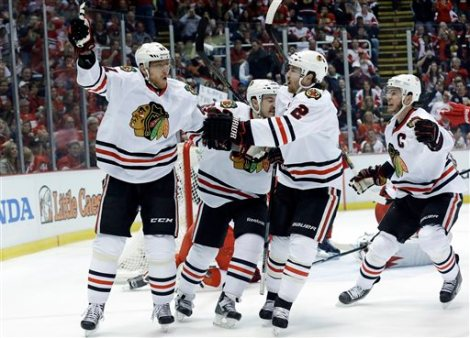 Paul Sancya/Associated Press  Chicago Blackhawks right wing Marian Hossa celebrates his  first period goal against the Detroit Red Wings with Andrew Shaw, Duncan Keith (2) and Jonathan Toews (19) in Game 6 of the Western Conference semifinals Monday in Detroit.