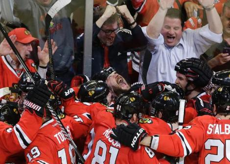 Nam Y. Huh/Associated Press  Chicago Blackhawks defenseman, and Game 7 hero, Brent Seabrook (looking up), celebrates after netting his OT goal Wednesday night.