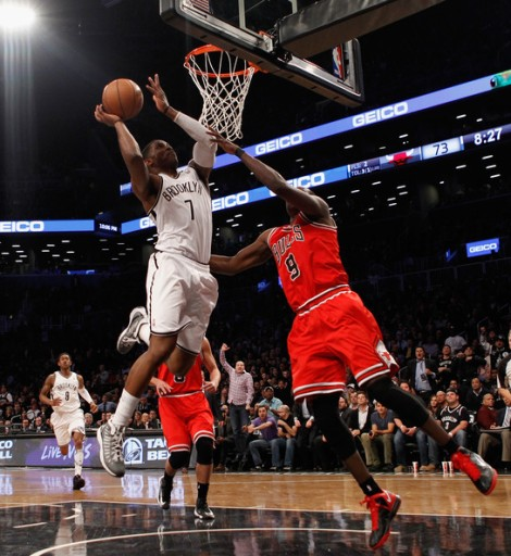 Bruce Bennett/Getty Images Joe Johnson is contested and fouled by Luol Deng during Game Two of the Eastern Conference Quarterfinals in Brooklyn. The Bulls defeated the Nets 90-82 and started this series on its competitive way.