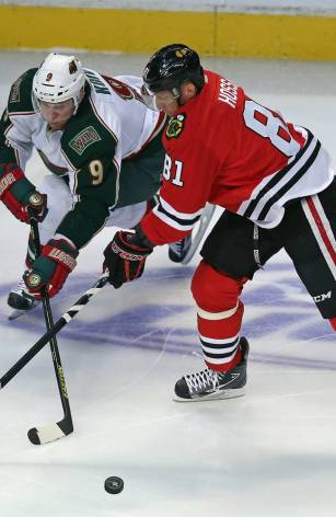 Jonathan Daniel/Getty Images Mikko Koivu of the Minnesota Wild knocks the puck away from Marian Hossa of the Blackhawks in Game Two of the Western Conference Quarterfinals at the United Center Friday night.