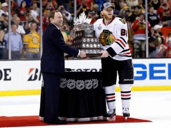 Greg M. Cooper/USA TODAY Patrick Kane poses with the Conn Smythe trophy after receiving it from NHL commissioner Gary Bettman Monday night.
