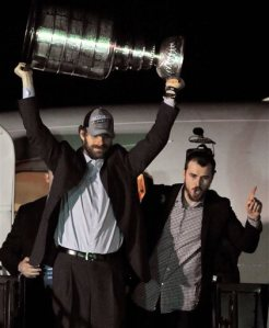 Paul Beaty/AP Michal Handzus carries the Stanley Cup after arriving at O'Hare Airport early Tuesday morning.