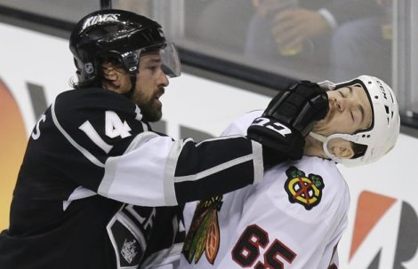 Jae C. Hong/ Associated Press Los Angeles Kings right wing Justin Williams gives Chicago Blackhawks center Andrew Shaw the business during the second period of Game 3 Tuesday night. Mankind and Socko would be proud.
