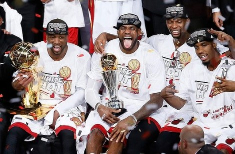 Dwyane Wade, Lebron James, Chris Bosh and Norris Cole (one of these things...) celebrate after Game 7 Thursday.