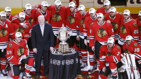 Reuters Members of the Chicago Blackhawks stand with the Clarence S. Campbell Bowl and NHL Deputy Commissioner Bill Daly after they advanced to the Stanley Cup by defeating the Los Angeles Kings in Game 5 of the Western Conference finals Saturday night.