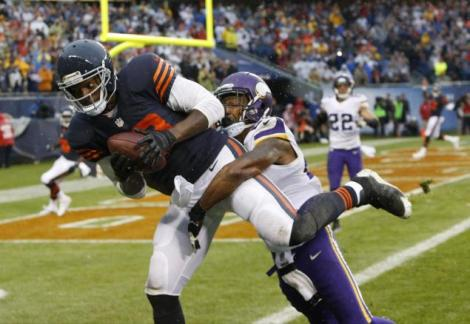 Charles Rex Arbogast/AP The Black Unicorn, Martellus Bennett, takes flight into the end zone to cap off the Bears' game-winning drive Sunday afternoon versus the Minnesota Vikings.