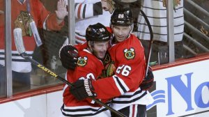 Charles Rex Arbogast/Associated Press Brandon Saad (20) and Michal Handzus celebrate Saad's goal during the third period Tuesday night in the Hawks' season opener against the Washington Capitals  The Blackhawks won 6-4.