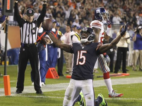 Andrew Mills/ USA TODAY Sports Hallelujah! Brandon Marshall celebrates after scoring the first of his two touchdowns against the New York Giants Thursday night at Soldier Field.