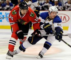 Nam Y. Huh/AP  The St. Louis Blues' Vladimir Tarasenko chases the puck as he battles against the Blackhawks' Marcus Kruger (16) during the first period last Thursday at the United Center.