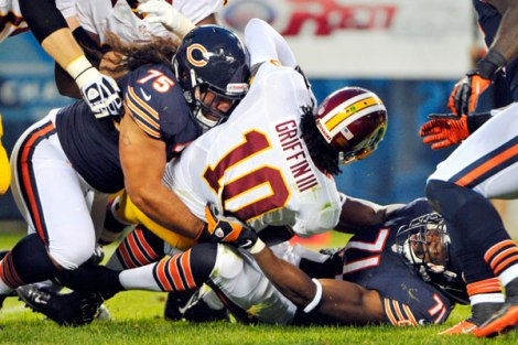 Rob Grabowski/US Presswire Defensive linemen Steven Paea and then-Chicago Bear Israel Idonije dump Robert Griffin III to the turf during a preseason game in 2012.