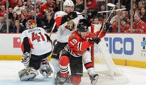 Bill Smith/NHLI via Getty Images Jonathan Toews maintains control near the net while taking contact from Chris Phillips #4 of the Ottawa Senators during action last Tuesday.