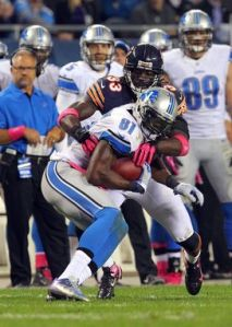 US PRESSWIRE Charles Tillman and Calvin Johnson lock up in the Bears and Lions' last match-up at Soldier Field.