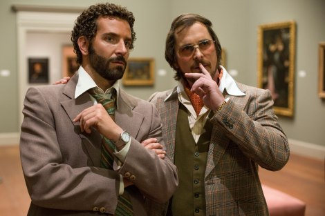 Sony Pictures  Bradley Cooper and Christian Bale (glasses) scope the scene in American Hustle, in theaters nationwide today.