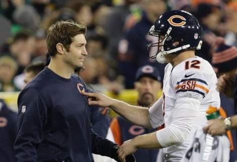 Associated Press Josh McCown talks to the street clothed Jay Cutler during the Bears' win at Green Bay last month. The roles will reverse as Cutler returns to the field this Sunday.