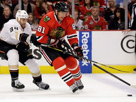 Nam Y. Huh/AP Marian Hossa, right, controls the puck against the Anaheim Ducks' Daniel Winnik during the second period of the Hawks' win over the current Western Conference leaders Friday.