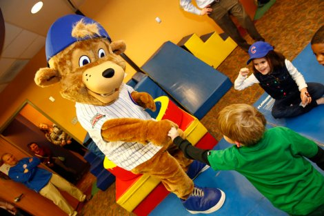 Steve Green/Chicago Cubs via Chicago Tribune Nobody loves me but my momma (and some kids): New Cubs mascot, Clark, meets children at Advocate Illinois Masonic's Pediatric Developmental Center in Chicago on Monday.