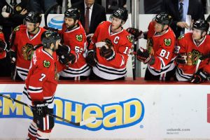 Paul Beaty/AP Brent Seabrook stops by the Hawks' bench after scoring the fifth goal in Chicago's 5-3 win over Edmonton Sunday night.