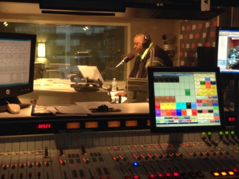 Demonze Spruiel ESPN 1000 radio personality Jonathan Hood prepares for a broadcast in the station's downtown Chicago studios earlier this month.