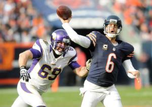 Chris Polydoroff/Pioneer Press Jared Allen runs down Jay Cutler as a member of the Minnesota Vikings in 2012. Once a tormentor of the Bears, Allen will now do his tormenting as a Monster of the Midway.