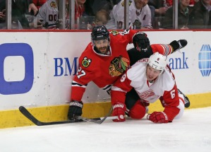 Jonathan Daniel/Getty Images Johnny Oduya mixes it up with Justin Abdelkader of the Detroit Red Wings in a 2014 clash.