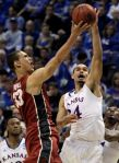 Jeff Roberson/AP Stanford's Dwight Powell, left, drives to the basket as Kansas' Perry Ellis defends during the second half of their game Sunday in St. Louis.