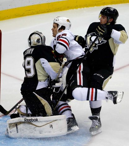 Gene J. Puskar/AP  The Blackhawks' Andrew Shaw gets caught between Pittsburgh Penguins goalie Marc-Andre Fleury (29) and Matt Niskanen, right, during Chicago's loss Sunday.