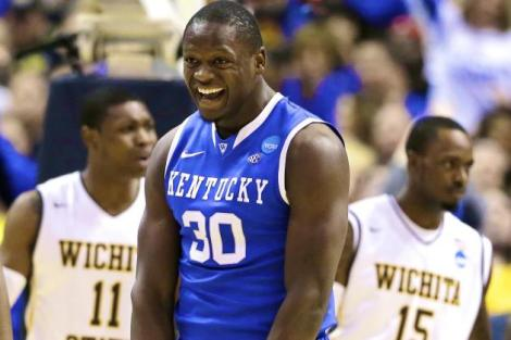 Associated Press  Kentucky forward Julius Randle celebrates an unlikely basket in the second half of the Wildcats' big win over Wichita State Sunday afternoon.