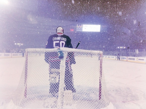 @TheSeanWoW/Lenny Gilmore/RedEye Chicago Chicago Blackhawks goalie Corey Crawford stands among the falling snowflakes and little pressure from Pittsburgh's offense Saturday night at Soldier Field.