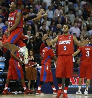 Associated Press ayton forward Kendall Pollard (22) celebrates after the second half in a regional semifinal game against Stanford at the NCAA tournament Thursday in Memphis, Tenn. Dayton won 82-72.
