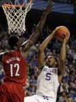 James Crisp/AP Kentucky's Andrew Harrison drives to the hoop as Louisville's Mangok Mathiang defends in these team's previous battle in December.