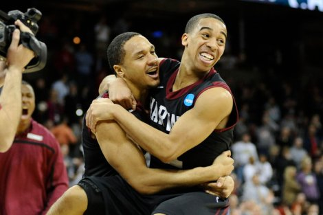 James Snook/USA TODAY Sports Harvard Crimson guard Brandyn Curry (10, left) and guard Siyani Chambers (1) celebrate after knocking off Cincinnati Thursday in a 12-5 upset. The Ivy League champs look to continue their run against another double-digit seed, North Dakota State, today.