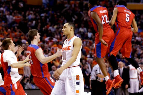 Associated Press/Frank Franklin II Syracuse's Tyler Ennis (11) reacts as Dayton's Kendall Pollard (22) and Devin Oliver (5) celebrate with teammates during the Flyers' upset win over the Orange in Buffalo, N.Y., Saturday.