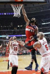 AP/Nam Y. Huh Wizards forward Nene dunks over Carlos Boozer and Joakim Noah during Washington's win over the Chicago Bulls in Game 1 of their opening-round playoff series in Chicago on Sunday.