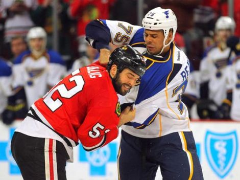 Dennis Wierzbicki/USA TODAY Sports The Blackhawks' Brandon Bollig goes head up with St. Louis' Ryan Reaves during an earlier contest. The Hawks and Blues will take the fight to each other in the 1st round of the NHL Playoffs starting Thursday.