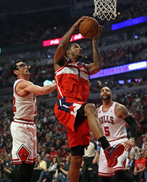 Jonathan Daniel/Getty Images  Trevor Ariza of the Wizards grabs a rebound over Kirk Hinrich and the Chicago Bulls during Game 5 of their series Tuesday night. Washington took this game and clinched the series.