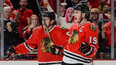 Bill Smith/NHLI via Getty Images Jonathan Toews (19) reacts with teammate Andrew Shaw after scoring against the St. Louis Blues in the third period of the Blackhawks' Game Six victory.