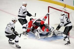 Jerry Lai/USA TODAY Sports Hawks center Jonathan Toews falls over Kings goalie Jonathan Quick in the most controversial play of Game 1, where a potential goal was disallowed.