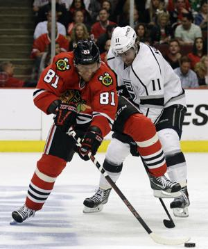 Nam Y. Huh/AP Chicago Blackhawks right wing Marian Hossa (81) and Los Angeles Kings center Anze Kopitar (11) battle for the puck during the second period in Game 5 of the Western Conference Finals.