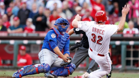 Joe Robbins/Getty Images Welington Castillo makes a tag attempt at Cincinnati's Jay Bruce earlier this week. Castillo has been an overall positive for the Cubs this season.