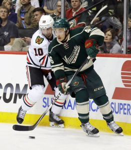Associated Press Minnesota defenseman Jared Spurgeon (46) chases the puck with Patrick Sharp right behind during Tuesday's Game 3 win for the Wild.