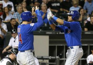 Charles Rex Arbogast/AP  Starlin Castro, right, celebrates his two-run home run with Anthony Rizzo,  during the fourth inning of the Crosstown Cup finale Thursday.