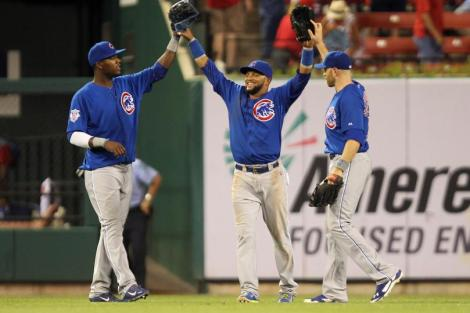 UPI/Bill Greenblatt Chicago Cubs (L to R) Junior Lake, Emilio Bonifacio and Nate Schierholtz celebrate the final out of a 17-5 win over the St. Louis Cardinals at Busch Stadium in St. Louis Monday night.