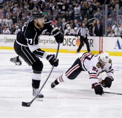Chris Carlson/AP L.A. Kings center Jeff Carter, left, shoots past Chicago Blackhawks defenseman Johnny Oduya during the second period of the Kings' Game 4 win in the Western Conference finals Monday night in Los Angeles.