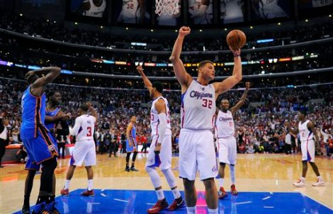 Mark J. Terrill/AP Hands in the air like ya just don't care: Blake Griffin celebrates with his Clippers squad as the Oklahoma City Thunder look on after giving up Game 4 of their Western Conference semifinal series, which the Clips won 101-99 Sunday.