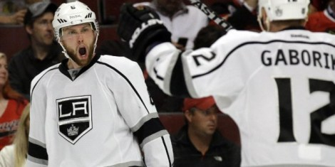 AP/Nam Y. Huh The Kings' Jake Muzzin reacts after scoring a goal during L.A.'s big third period in their Game 2 win in the Western Conference finals against the Blackhawks Wednesday night.