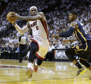 AP Photo/Wilfredo Lee LeBron James (6) drives the ball as Indiana Pacers forward Paul George (24) defends, during the second half of the Miami Heat's Game 4 win Monday night, the defending champs are now up 3-1 in the Eastern Conference Finals.