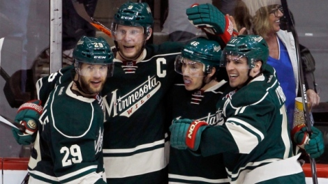 Ann Heisenfelt/AP Minnesota Wild right wing Jason Pominville (29), center Mikko Koivu (9),  defenseman Jared Spurgeon (46) and Minnesota Wild left wing Zach Parise, right, celebrate after Spurgeon scored on the Chicago Blackhawks during the Wild's Game 4 win.