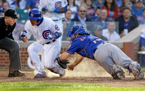 Nam Y. Huh/AP Darwin Barney just gets past Mets catcher Travis d'Arnaud for a run scored in the Cubs' 7-4 win Thursday night.
