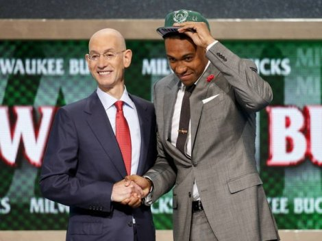 Jason DeCrow/Associated Press Jabari Parker of Duke poses for a photo with NBA Commissioner Adam Silver after being selected by the Milwaukee Bucks as the number two overall pick during the 2014 NBA draft, Thursday in New York.