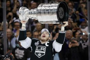 Jae C. Hong/AP  Los Angeles Kings right wing Dustin Brown raises the Stanley Cup after beating the New York Rangers.